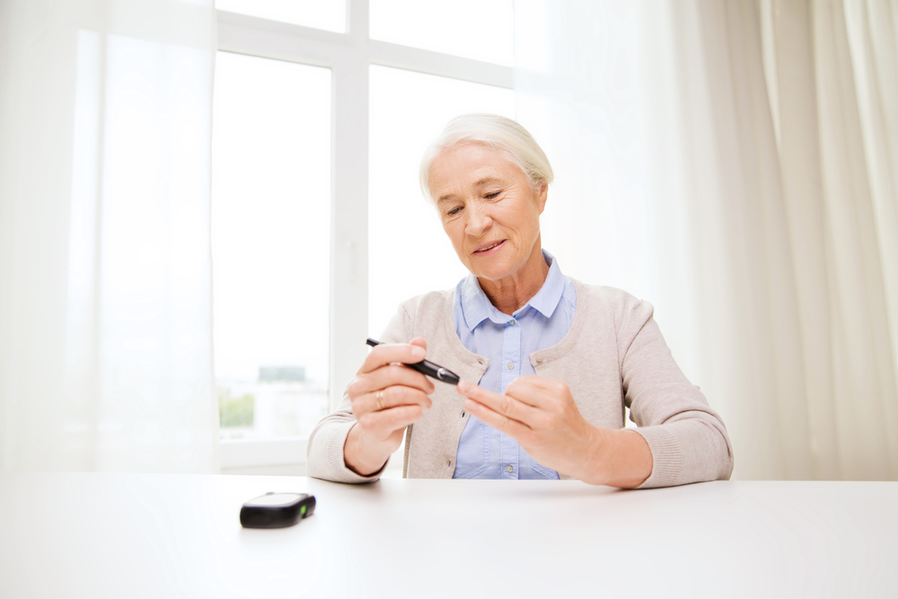 senior woman monitoring her blood glucose